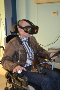 Having a go at the virtual reality head sets provided by advent wisdom.